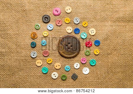 Many  Vintage  Buttons  On The Old Cloth