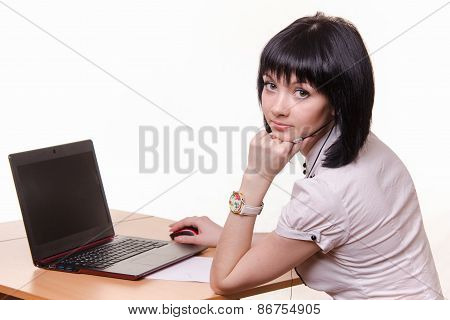 Call-center Worker At A Table With Laptop