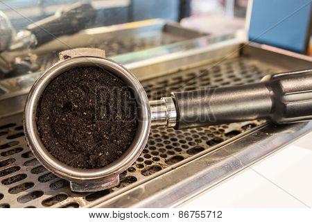 Grounded Espresso In A Portafilter.