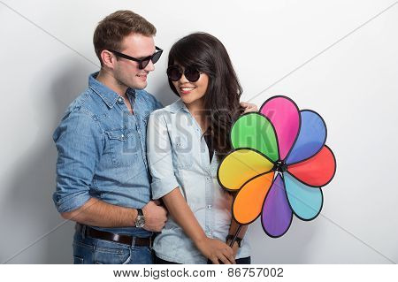 Happy Young Multiculture Couple Posing With Windmill