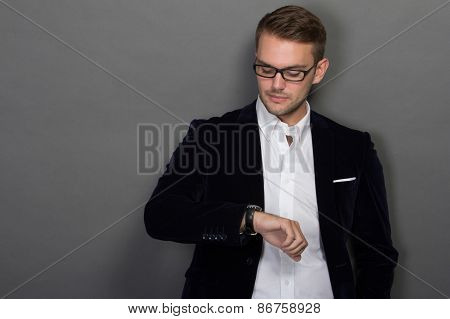 Young Businessman Look At His Watches
