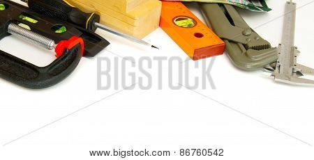 Many working tools - caliper, ruler and others on white background.