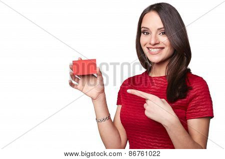Young smiling beautiful sexy woman showing empty blank sign or gift card. Isolated on white backgrou