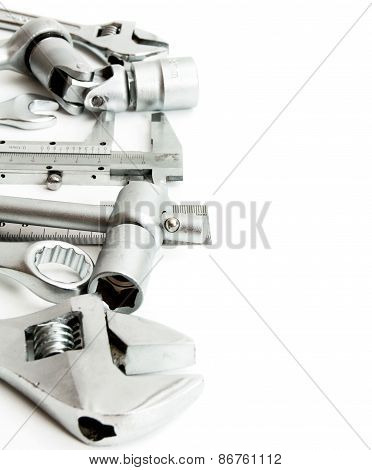 Metalwork. Spanner , ruler, caliper and others tools on white background.