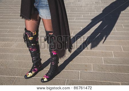 Shadow Of A Young Woman Wearing Over The Knee Boots