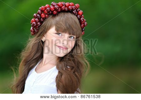 Portrait Of Little Girl With A Wreath Of Cherry