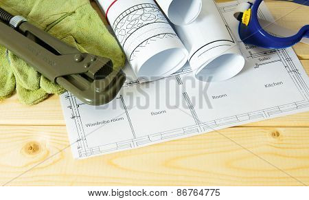 Repair work. Drawings for building and working tools on wooden background.