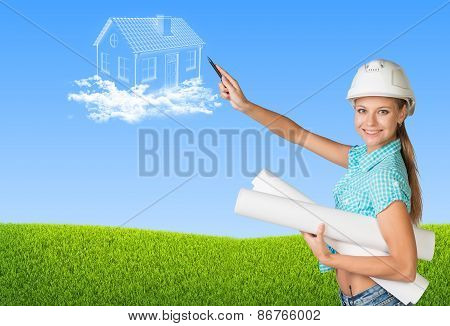 Beautiful builder holding scrolls and points to house in clouds