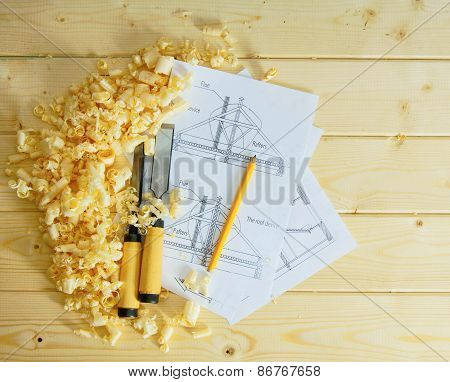 Woodworking. Drawings for building and working tools on wooden background.