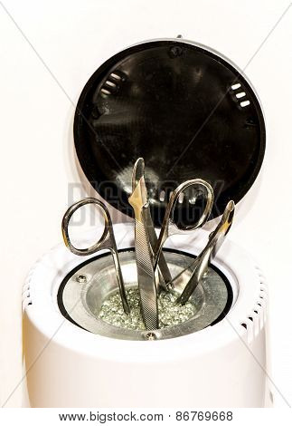 Manicure Accessories In Sterilizer Isolated