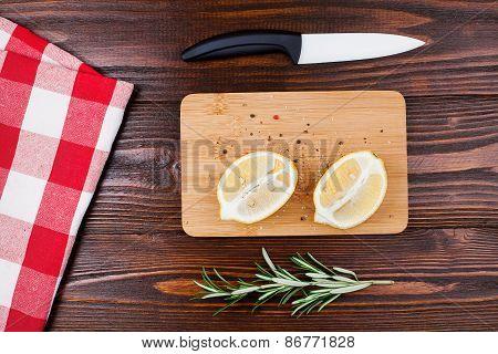 lemon halves on wooden table