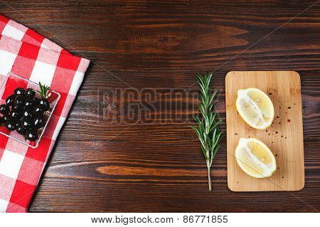 Olives on wooden table