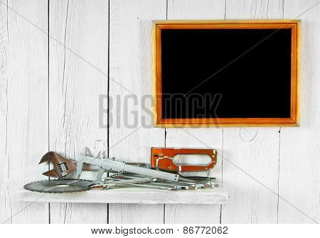 Working tools on shelf and frame .