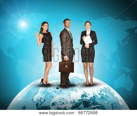 Three business person standing on Earth surface