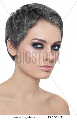 Portrait of young beautiful woman with trendy grey hair and stylish haircut over white background