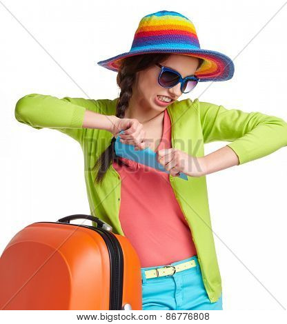 Portrait of female tourist with travel suitcase and blue boarding pass, isolated on white