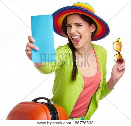 Portrait of female tourist with travel suitcase and boarding pass, isolated on white