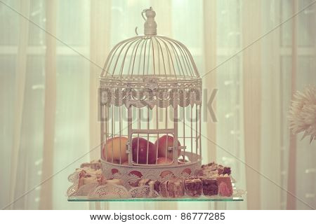 Wedding Decoration With Apples Inside The Birdcage