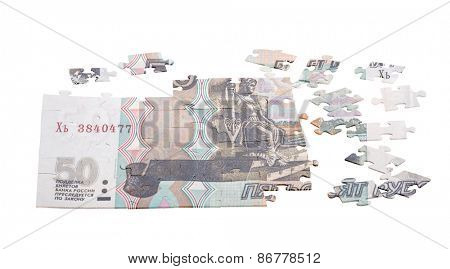 unfinished puzzle from fifty Russian roubles isolated on white background