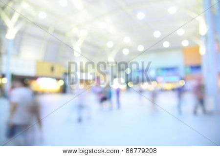 People Shopping In Department Store. Defocused Blur Background.