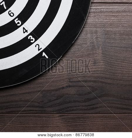 black and white target on wooden background