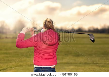Golfer Watching Her Drive From The Tee