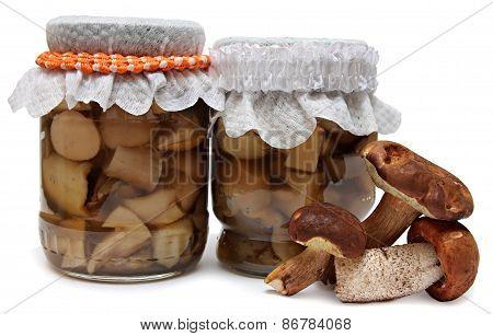 Marinaded mushrooms isolated on white background.