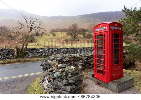 An iconic English telephone box in the Lake District National Park. The phone boxes were once important for communication but fell into disuse after mobile phones were invented.