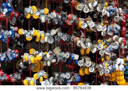 Colorful casters hanging in a Vietnamese street shop