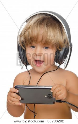 Happy Child With Headphones And Smartphone