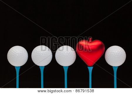 Golf Balls And Red Heart On Wooden Tees