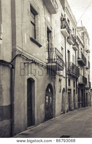 Narrow Empty Street View Of Tarragona. Vintage Stylized