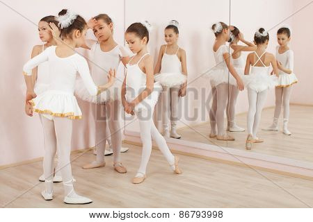 Group Of Six Little Ballerinas Preparing For Performance