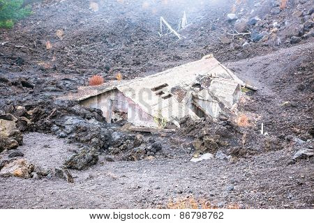 Ruins of a house that was buried under lava  surrounded by fog on Etna region , Sicily, Italy.  The house was 14km from the Etna Volcano.