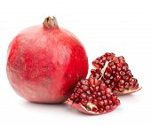 stock photo of whole-grain  - whole pomegranate with pieces and grains isolated on white background - JPG