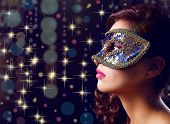 foto of masquerade mask  - Beautiful girl with masquerade mask on lights background - JPG