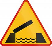 stock photo of movable  - Polish sign warning about a movable bridge - JPG
