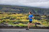 pic of cardio  - Athlete male runner running on mountain road - JPG