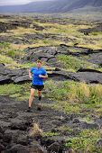 picture of cardio exercise  - Trail Running fitness male ultra runner in nature landscape - JPG