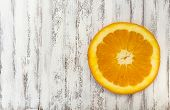 picture of florida-orange  - Orange slice on a white background on the right - JPG