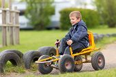 picture of buggy  - a Boy having fun with buggy cart - JPG