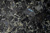 image of granite  - Black background of granite stone on kitchen countertop material with chunks of rock and stone material - JPG