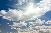 image of puffy  - Beautiful Deep Blue Sky and Puffy Clouds With Sun Rays - JPG