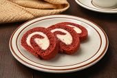 foto of red velvet cake  - Slices of red velvet cake roll with a cup of coffee - JPG