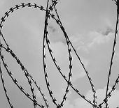 Razor Wire And Dark Clouds