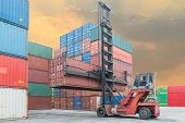 stock photo of weight lifter  - Crane lifter handling container box loading to depot - JPG