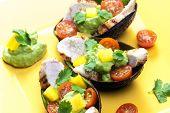 stock photo of avocado  - avocado filled with chicken salad and avocado dip - JPG