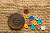 image of hasp  - A lot of old buttons scattered on the old cloth - JPG