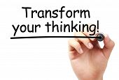 foto of transformation  - Transform your thinking text is written on transparent white board by hand with marker isolated - JPG