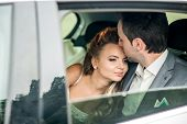 picture of fondling  - Wedding photo groom and bride in the car - JPG